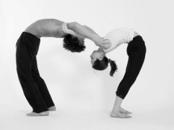 Woman Lifts Man in Dance