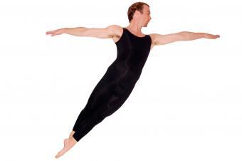 Male ballet dancer doing cabriolé movement