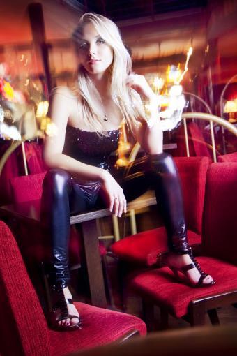 Blonde girl with shinny leggings