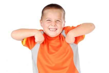 Boy doing the chicken dance; © Nikolay Mamluke | Dreamstime.com