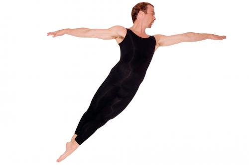 Male ballet dancer doing cabriolé movement