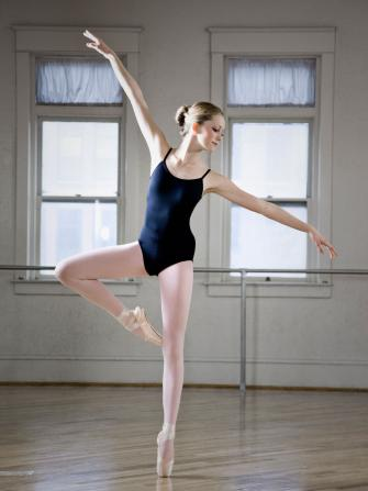 Young girl in ballet emboité move