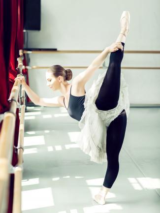 Ballerina doing penché in studio