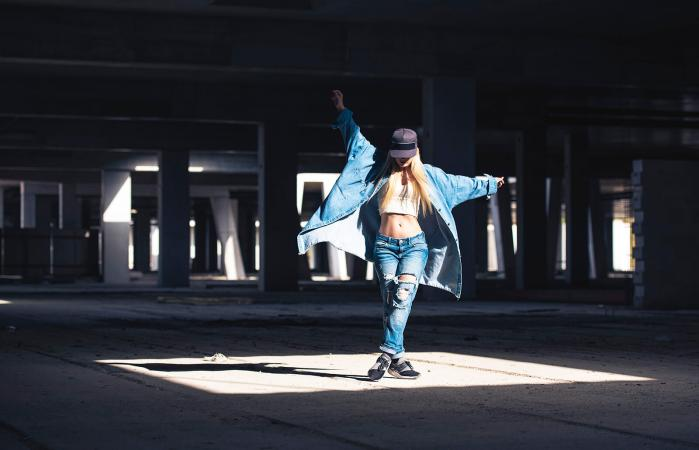 Female dancer dancing in abandoned building