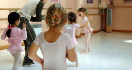 Young ballerinas getting instruction