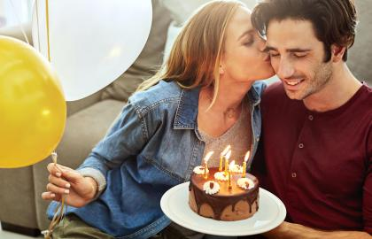Couple celebrating a birthday at home