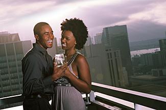couple flirting outside on balcony