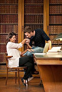Man kissing girlfriend's hand