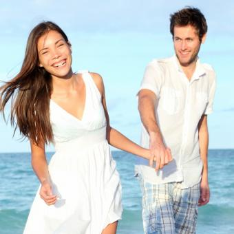 Young couple holding hands at the beach