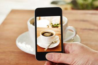 Smartphone taking picture of coffee