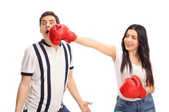 Cheerful woman punching her boyfriend