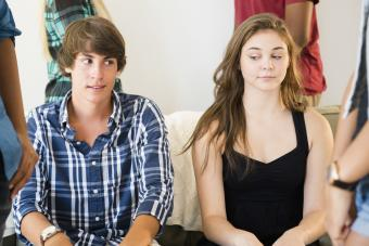 Awkward curious teenage couple