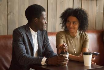 man and woman talking flirting