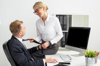 Woman flirting with boss