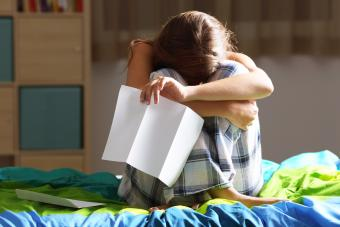 Sad woman after reading a letter