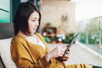 Woman enjoying online romance novel
