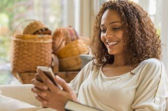 Woman reading text message on phone