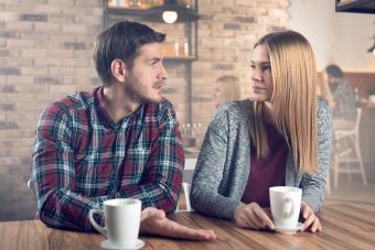 Man explaining himself to girlfriend