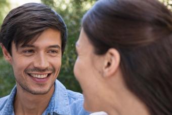 Man smiling at girlfriend