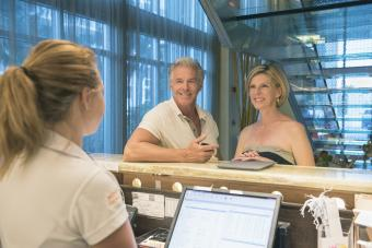 Couple checking into a nice hotel together