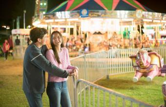 Teenage couple at the fair