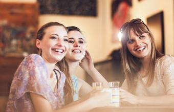 teenage friends talking at the coffee bar