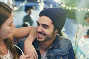 Couple laughing and relaxing at a party