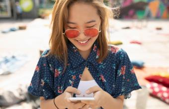 Teenage girl using smart phone