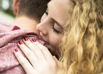 Teenage girl embracing her boyfriend