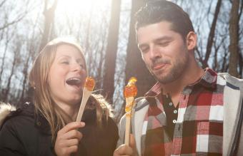 couple eat Maple taffy on a sunny day