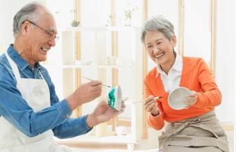 Senior Couple Painting Earthenware