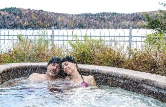 Woman and man relaxing in hot tub