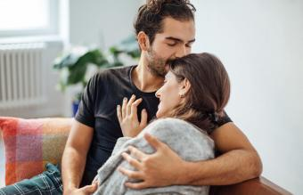 Man embracing girlfriend