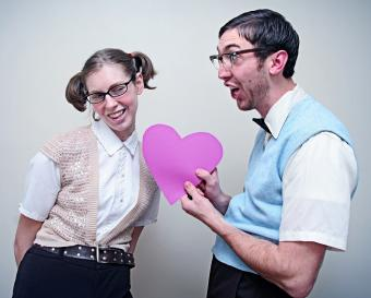 Nerd Guy and Girl in Love Holding A Heart