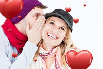 Boyfriend whispering funny valentine poem to girlfriend