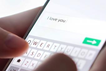 Sending I love you text message with mobile phone