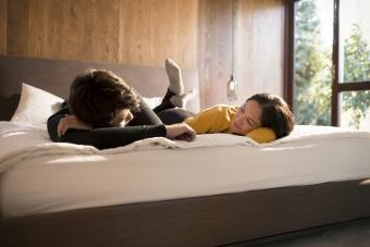 Couple laying on bed talking