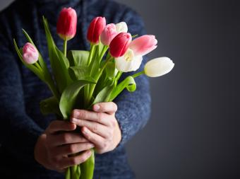 Male holding bunch of tulips