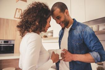 couple with coffee in kitchen