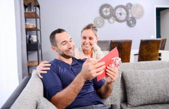 Woman giving gift to her boyfriend