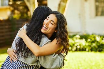 Two women friends embracing
