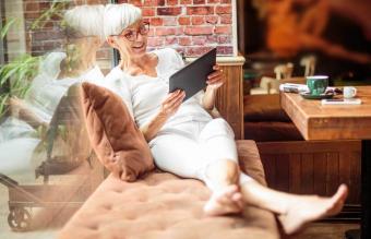 Senior woman with digital tablet