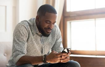 man using smartphone app
