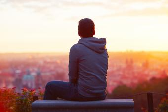 Young man looking at the sunrise