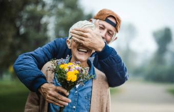 Man giving romantic flowers to wife