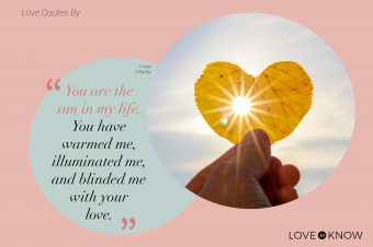Hand holding yellow leaf of heart shape with sun rays