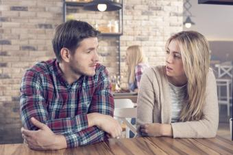 Young couple having a serious conversation in a bar