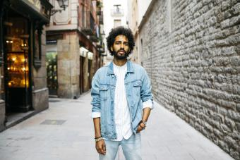 Bearded young man with curly hair in Barcelona