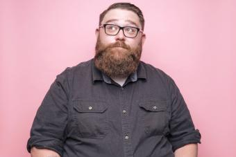 Bearded man on pink background
