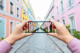 man photographing colorful street